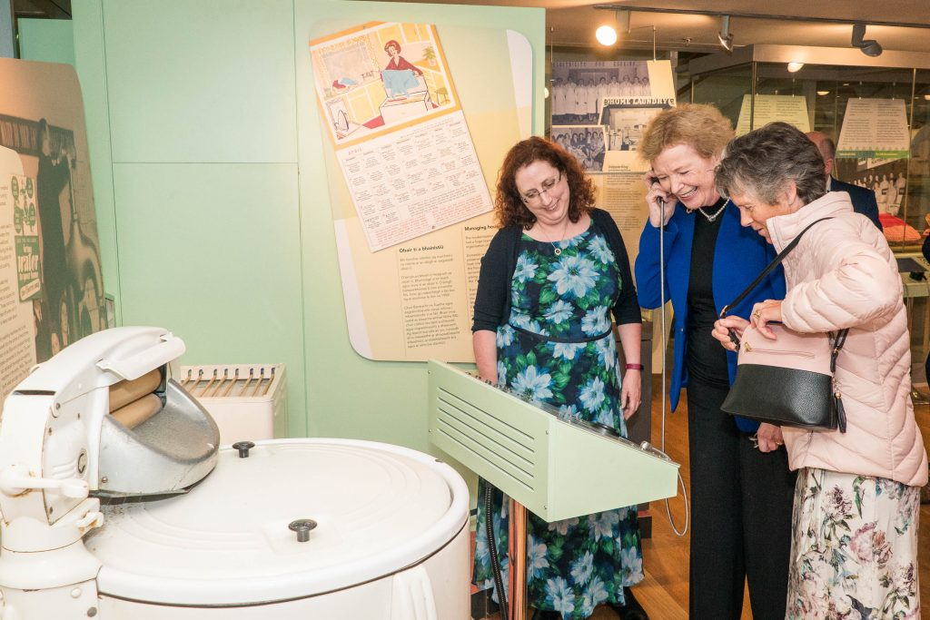 Sorcha O'Brien and interview participant Brigid O'Brien showing Mary Robinson the oral histories